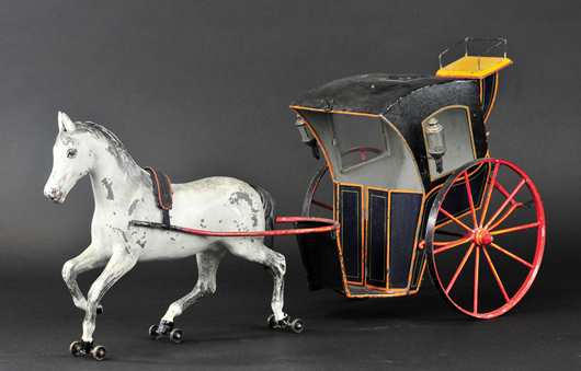 Marklin (Germany) oversize hansom cab, 28in long, est. $15,000-$18,000. Bertoia Auctions image