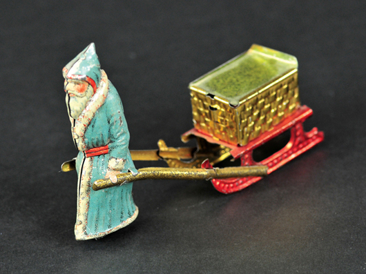 Father Christmas penny toy, Meier (Germany), lithographed tin with removable lid on basket for access to candy, est. $4,000-$5,000. Bertoia Auctions image