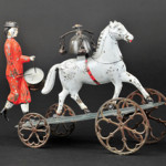 Althof Bergmann suffragette drummer with horse bell toy, hand-painted tin, cast-iron wheels, 10in long, est. $1,800-$2,250. Bertoia Auctions image
