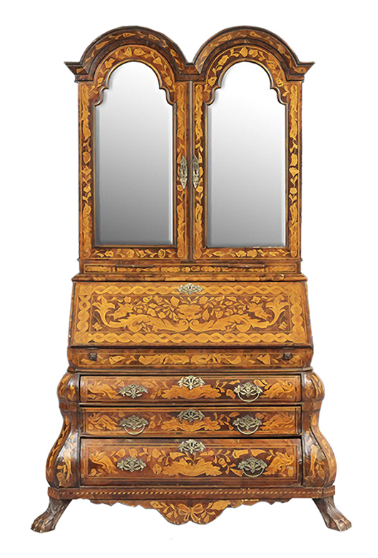This 19th century Dutch walnut secretary with inlay sold for $2,214 at New Orleans Auction Galleries. It is an example of the bargains that are now seen at auctions because of the drop in prices of what the trade calls 'brown furniture.'