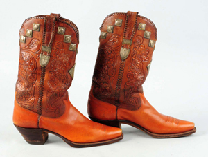 Handmade tooled leather cowboy boots made for cowboy film star Tom Mix, 1930s-40s, possibly made by Blucher, exhibited at the Museum of the Horse in New Mexico, est. $400-$600. Morphy Auctions image