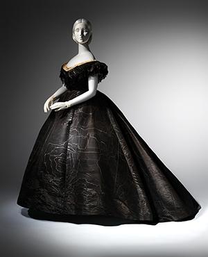Evening dress, circa 1861, black moiré silk, black jet, black lace. Lent by Roy Langford (C.I.L.37.1a). Photo: © The Metropolitan Museum of Art, by Karin L. Willis