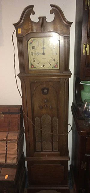 Vintage Philco Grandfather Radio Clock. Image courtesy of LiveAuctioneers.com archive and Tim's Inc.