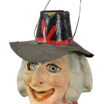 This 5-inch-tall witch-head jack-o'-lantern made in Germany is probably from the 1920s. Although the paint has been touched up, it sold for $1,121 at a 2014 Bertoia auction in Vineland, N.J.