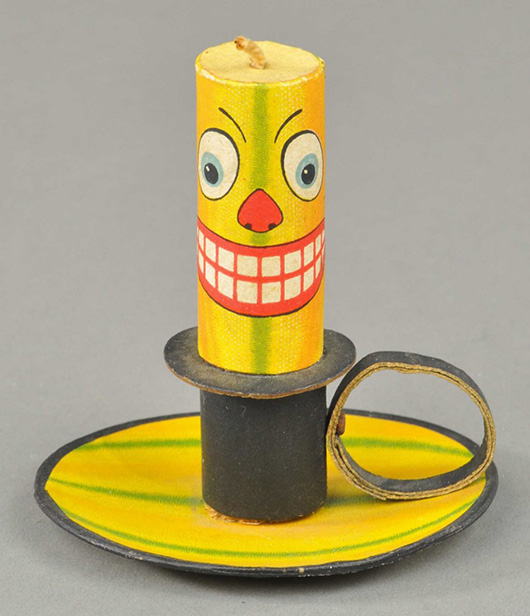 Jack-o-lantern candlestick and holder, ex Tom Fox collection, 4¼ in tall, featured in Mark B. Ledenbach's book 'Vintage Halloween Collectibles,' sold at Bertoia's for $4,950 on Nov. 10, 2013. Image courtesy LiveAuctioneers Archive and Bertoia Auctions