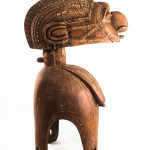 Baga D'Mba tribe carved wood fertility headdress, Guinea - Niger River region, 20th century, carved wood with metal studs. Estimate $5,000-$7,000. Gray's Auctioneers image