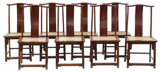This set of eight huanghuali and hardwood side chairs, each with a woven seat, will be offered at $120,000 to $140,000. Clars Auction Gallery image