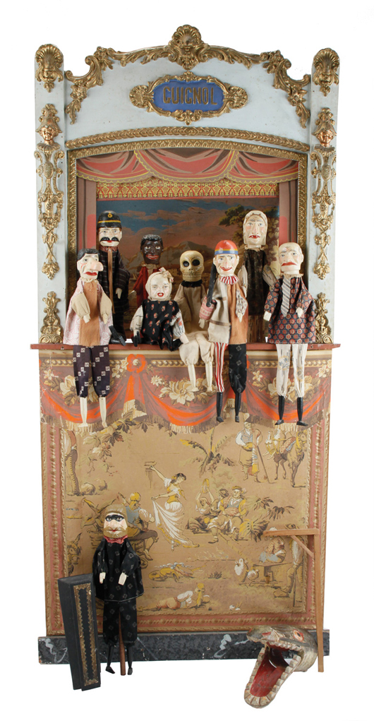 Elaborate 58-inch-tall Punch & Judy stage with crank operated curtain and 10 cloth-dressed, painted wood puppets, est. $2,500-$3,500. Noel Barrett image
