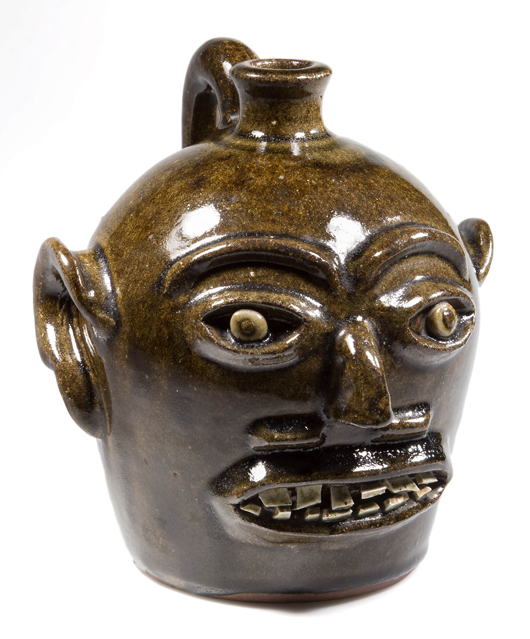 Harvey Ford Reinhardt (attributed), Lincoln County, North Carolina, face jug, circa 1937, 8 inches high. Jeffrey S. Evans & Associates image