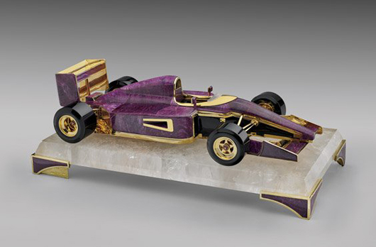 Tanzanian ruby Ferrari F1 scale model by Luis Alberto Quispe Aparicio, with Russian obsidian (tires, chassis and engine), rock crystal from Madagascar (base and windshield) and gold vermeil (all metalwork). Estimate: $250,000–$350,000. I.M. Chait Gallery / Auctioneers image.