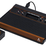 The third version of the Atari Video Computer System, with 'wood veneer' and standard joy stick, sold from 1980 to 1982. Image by Evan-Amos, courtesy of Wikimedia Commons.