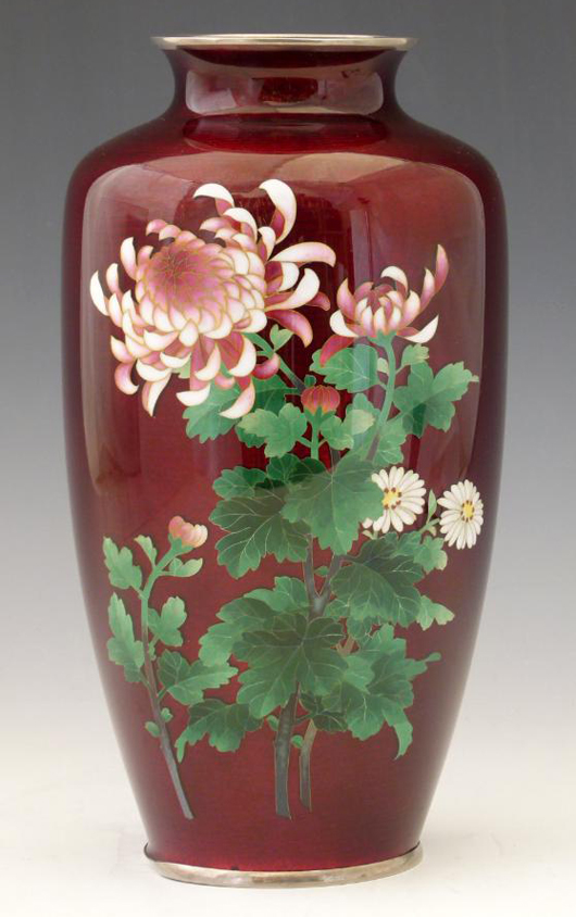 A Japanese cloisonné vase decorated with flowers on a red ground, estimate £350-450. Photo: Peter Wilson