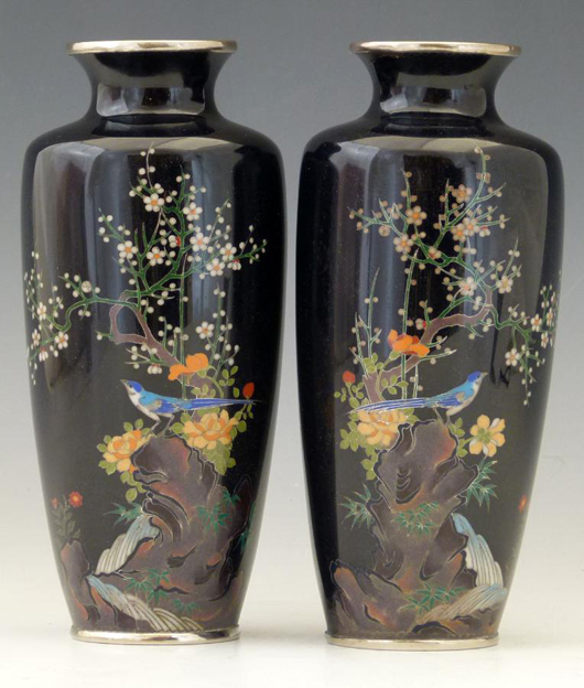 A pair of Japanese blue/black cloisonné vases decorated with a blossom on a rocky outcrop, estimate £100-200. Photo: Peter Wilson