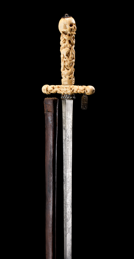 German town sword with finely carved ivory 'memento mori' hilt, dated 1656, the year the plague killed hundreds of thousands people in Europe. The entire hilt carved in relief as a series of serpents entwined with toads and human bones, the guard terminals and the pommel formed as skulls. Estimate: £6,000-8,000. Thomas Del Mar Ltd. image