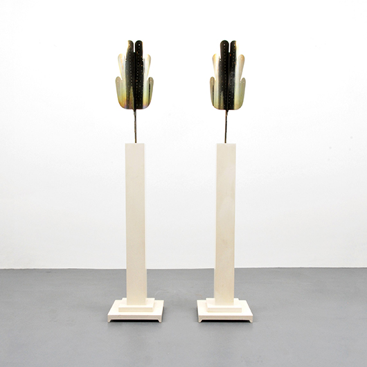 Pair of Tommi Parzinger floor lamps with pierced brass shades, est. $6,000-$8,000. PBMA image