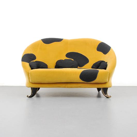 "Elizabeth Garouste and Mattia Bonetti upholstered ""Aladdin"" sofa with turned-out brass feet, French, est. $25,000-$35,000. PBMA image"