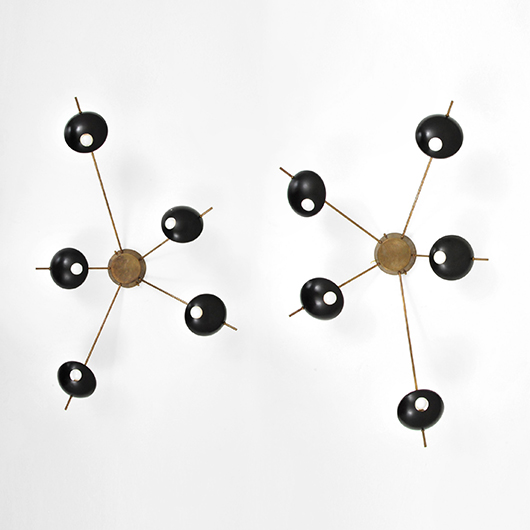 Pair of large Stilnovo brass and enameled-metal 5-arm sconces or ceiling lights with 'atomic' motif. Estimate: $10,000-$15,000. PBMA image