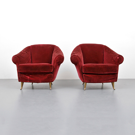 Pair of deep crimson Gio Ponti Model 12690 upholstered lounge chairs with brass feet, est. $20,000-$30,000. PBMA image