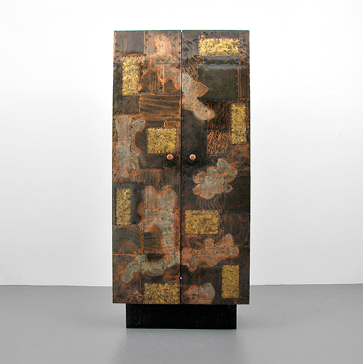 Paul Evans 80in mixed-metal cabinet and dry bar with double doors and interior drawers, shelves and storage. Pictured 'Paul Evans Designer & Sculptor' by Jeffrey Head. Est. $20,000-$30,000. PBMA image