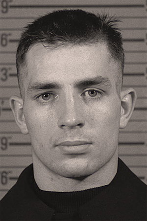 Jack Kerouac in a Naval Reserve enlistment photograph, 1943. Image courtesy of Wikimedia Commons.