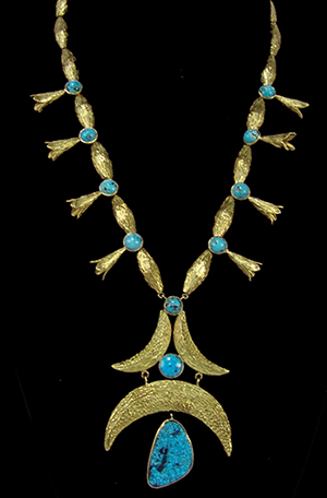 Early 1970s 14K gold necklace with custom beads, squash blossoms and spiderweb turquoise stone. Price realized: $5,750. Allard Auctions Inc. image