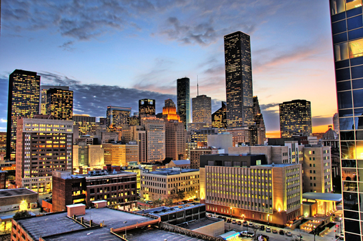 Night view of the northern end of downtown Houston, a booming metropolis with a vibrant art scene. Wikimedia Commons image licensed under the Creative Commons Attribution 2.0 Generic license.