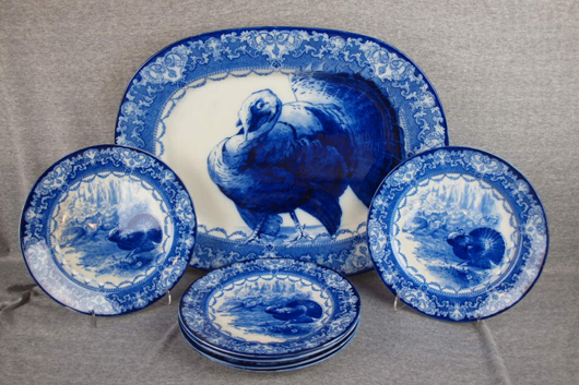 Doulton Watteau flow blue turkey platter (21 x 17in) with six matching plates. Sold for $1,334 by Strawser Auctions on May 24, 2012. Image courtesy of LiveAuctioneers Archive and Strawser Auctions