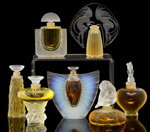 A group of stylish 20th century Lalique perfume bottles that would make great gifts and, perhaps, greater investments. The most valuable is the one shown at top right from the limited edition Ondines (Mermaid) collection of 1998. It sold for £280. Photo Ewbank's Auctioneers