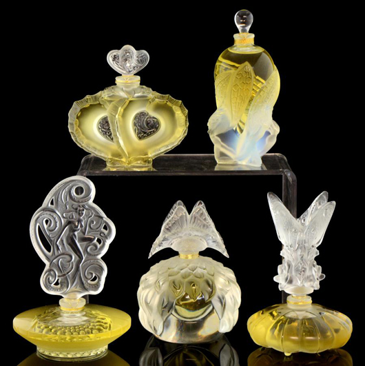 Modern Lalique perfume bottles clockwise from top left: Deux Coeurs (Two Hearts), which sold for £140; Les Elfes (The Elves), £260; Les Fees (The Fairies), £220; Papillion (Butterfly), £240: and Songe (Dream). £180. Photo Ewbank's Auctioneers