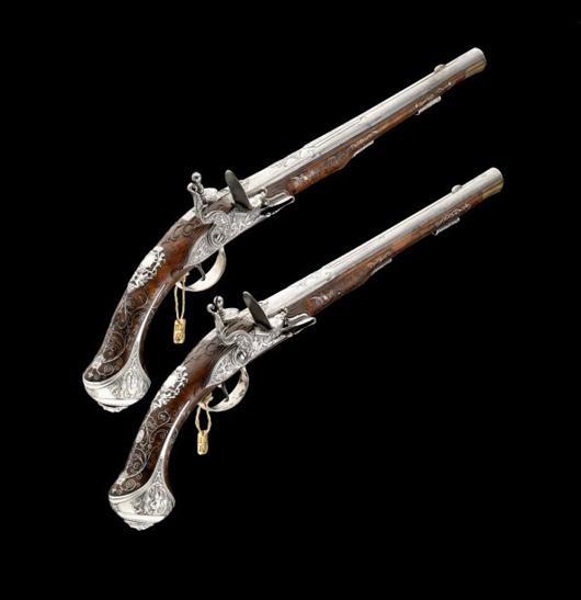 Exceptional pair of Bohemian silver-mounted flintlock holster pistols by Paul Poser in Prague, circa 1725, 21 1/4-inch barrels. Estimate: £18,000-20,000. Thomas Del Mar Ltd. image