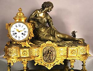 French dore gilt bronze mantel clock with ormolu, depicts lady feeding nest of birds in a pond to her left, solid bronze case with marble inserts and foliage, signed, est. $1,600-$2,400. Bruhns image