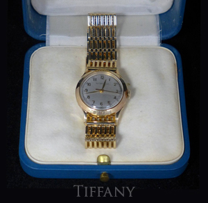 Tiffany & Co. man's 14K gold wristwatch with original case. Approx. total weight 537 grams. Est. $2,000-$2,500. Sterling Associates image