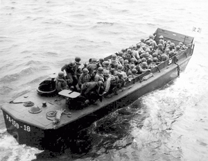A Navy landing craft carrying Army troops, possibly as reinforcements at Okinawa in April 1945. US Navy photo, courtesy of Wikimedia Commons.