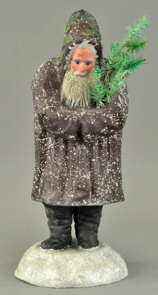 All Belnickles are fragile, but it's especially amazing that this 20-inch figure with glass eyes and a glass icicle beard survived intact. The rare figure, standing on a mica-flecked snow mound and cradling a feather tree, fetched $17,000 at Bertoia Auctions' November 2013 sale. Photo courtesy Bertoia Auctions.