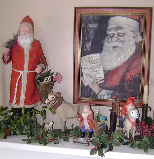 Jones uses her Belsnickles to decorate with at Christmas time. Here a few Belnickles on her fireplace mantel with an advertising painting of Santa Claus by artist Fred Craft. Photo courtesy Lorraine Jones.