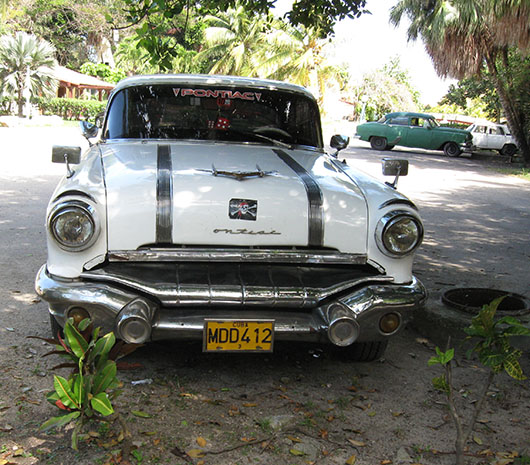 A 1950s Pontiac parked on a street in Cuba. Image by Zahav511. This file is licensed under the Creative Commons Attribution-ShareAlike 3.0 Unported license.