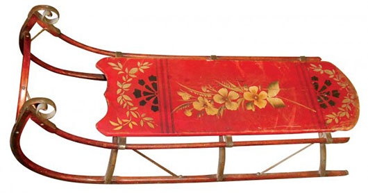 Child's sled decorated with hand-painted flowers and original red paint. Image courtesy LiveAuctioneers.com archive and Rich Penn Auctions.
