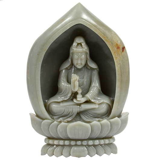 Carved white jade boulder depicting the goddess Guanyin seated inside a shrine on double lotus base, 11½ inches high. Est. $30,000-$40,000. AGOPB image