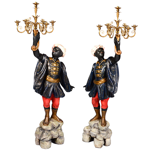 Pair of polychrome blackamoors, each 78 inches high with a raised arm supporting a seven-light candelabrum. Est. for the pair $1,500-$2,000. Ex Estate of Robert Gottfried, Palm Beach, Florida. AGOPB image