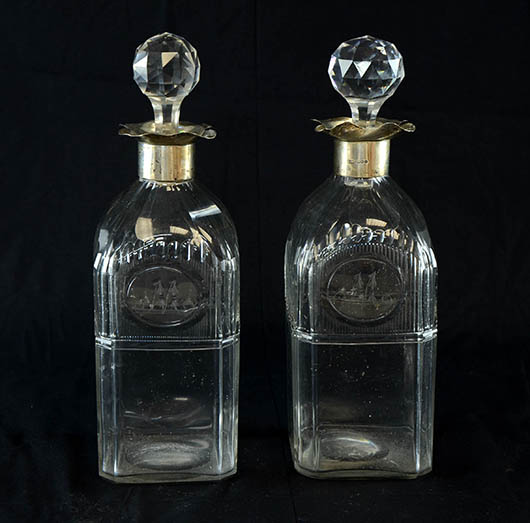 A pair of George V cut glass decanters with silver mounts, assayed in London in 1910, sold for £190. Photo Ewbank's Auctioneers