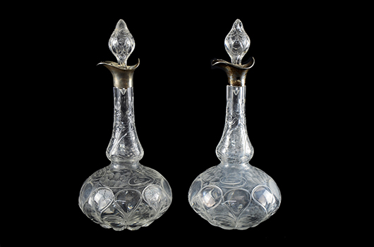 A good pair of rock crystal glass silver mounted decanters by Stevens and Williams engraved with water lily design, the mounts hallmarked London 1903. Sold for £1,200. Photo Ewbank's Auctioneers