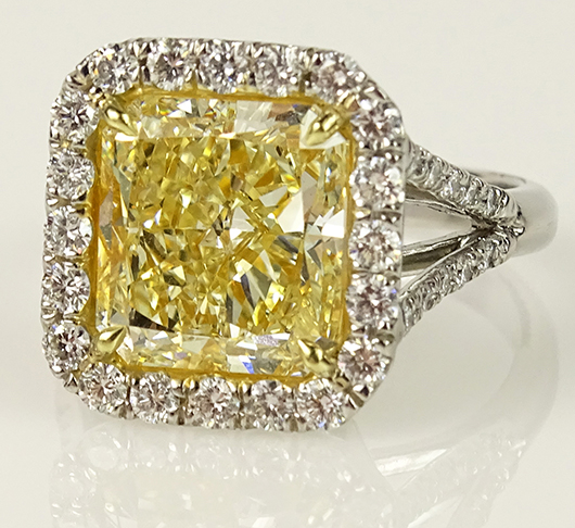 Platinum ring with fancy intense yellow diamond, 6.05 carats. Price realized: $59,000. Kodner Galleries image.