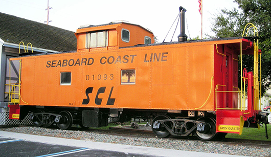 Former Seaboard Coast Line Railroad class M-6 caboose on display at the Mulberry Phosphate Museum in Mulberry, Fla. Image by Harvey Henkelmann, courtesy of Wikimedia Commons.