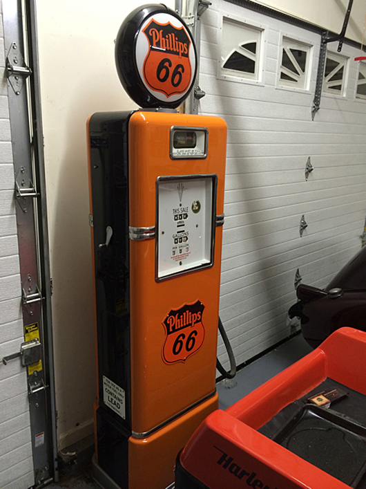 Fully restored gasoline pump with the Harley-Davidson colors and Phillips 66 logo on the top. Tim's Inc. Auctions image