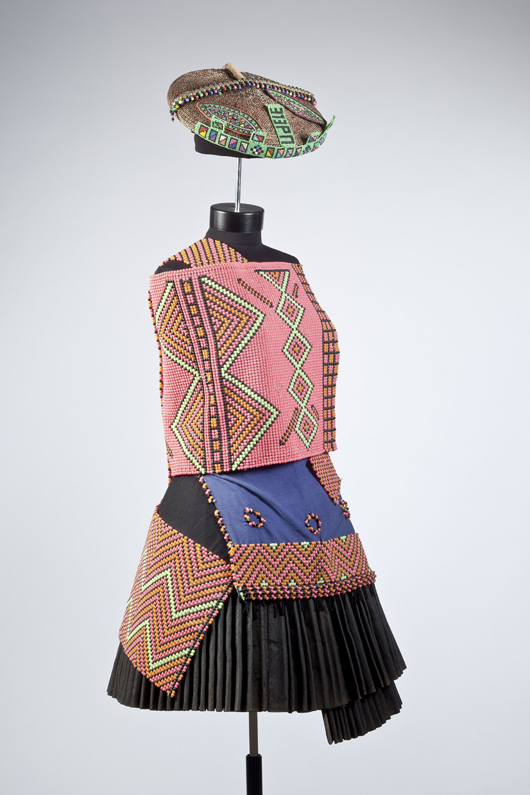 Bridal ensemble. South Africa, c. 1960. Plastic beads, leather, cotton, thread, cloth, wire and tin buttons. Worn by Ntombiyise Mandwandwe Shiza. Image courtesy of the Newark Museum