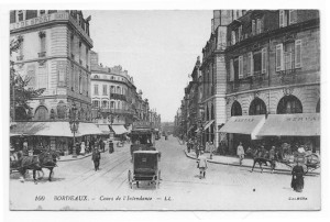 This busy street view of Bordeaux (Cours de l'Intendance) shows early automobiles and horse-drawn vehicles.