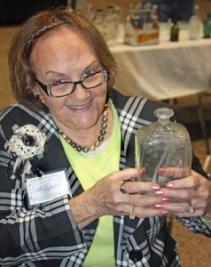 Marti Newman shows off her Steigel-type glass flask.