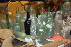 Seabed bottles, some of them encrusted with barnacles.