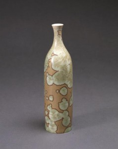 Taxile Doat, who came to University City directly from the Sevres factory in France, had literally written the book – 'Grand Feu Ceramics' – on porcelain manufacture. Among his works now in the collection of the St. Louis Art Museum is this variation on a traditional Japanese sake bottle covered with a crystalline glaze. St. Louis Art Museum image