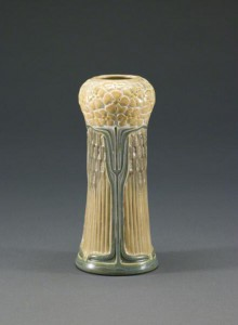 This diminutive vase topped with yellow phlox demonstrates Adelaide Alsop Robineau's mastery of the porcelain process. Made at University City in 1910, the elaborately carved vase features cutout reticulations filled with translucent glaze. St. Louis Art Museum image